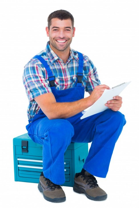 gallery/happy-plumber-writing-clipboard-while-sitting-toolbox_13339-172329